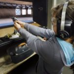 Belen Renteria, 10, shoots at a target at the Los Angeles gun club in Los Angeles